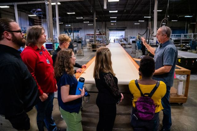Students touring the production floor at SeaDek headquarters