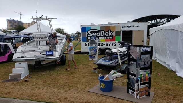 JetBoat Pilot exhibiting at the Emerald Coast Boat Show with SeaDek on Display next to a boat.