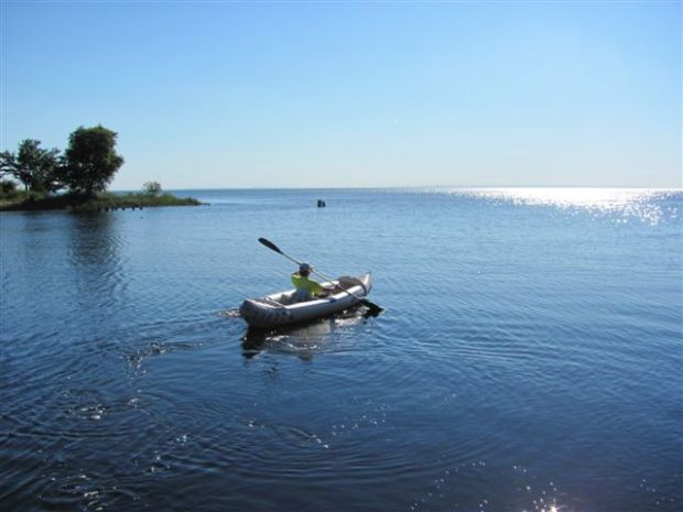 """Linda paddles out into Whitefish Bay in Lake Superior on a recent tent camping vacation. """"Best vacation I ever had,"""" she says."""