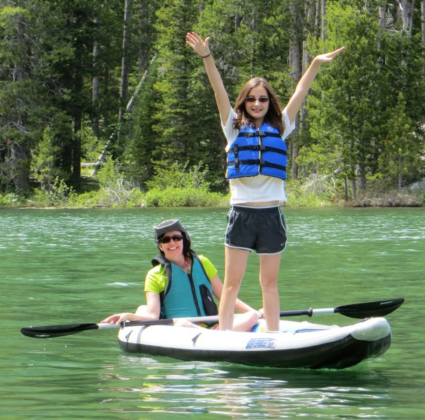 Wendy, seated, and her neice, Kenedy, 13, ply the waters in Wendy's FastTrack 385. Kenedy and her brother, Connor, 16, frequently accompany the Wendy and Patrick Graves on vacation. Looks like a good time!
