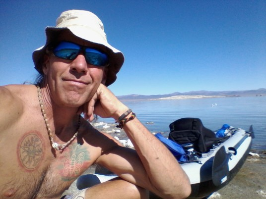 Tim takes a break from paddling California's Mono Lake in his FastTrack. Fun in the sun...does it get any better than this?