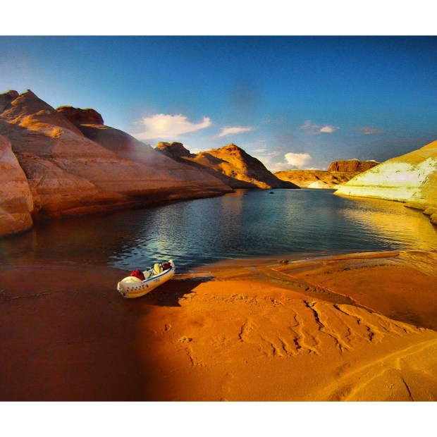 """""""The Earthblazers kayaked into Lake Powell's slot canyons, a remarkable maze of waterways. I found this canyon as the sun was setting,"""" says Ryan."""