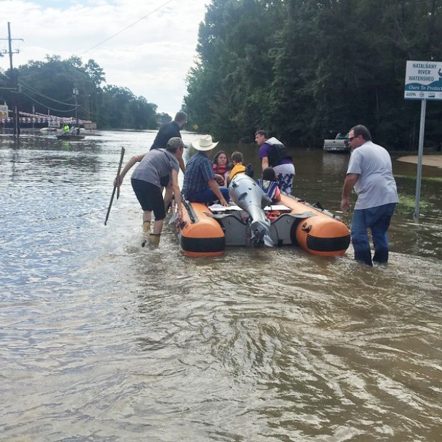 """Clay ferried stranded neighbors from their flooded homes to safer, higher ground. The local Fire Chief said, """"If I hadn't seen what that boat could do, I wouldn't have believed it."""""""