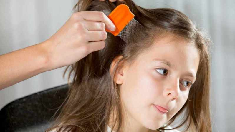 little-girl-being-checked-for-lice-16-x-9