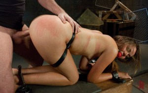 Tied up and cuffed slave has a ball gag and is fucked doggy-style