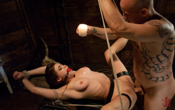 Tied up and gagged slave gets her body covered in wax while being fucked