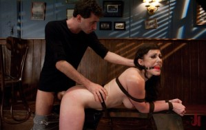 Bound in leather and gagged client is getting fucked doggy-style