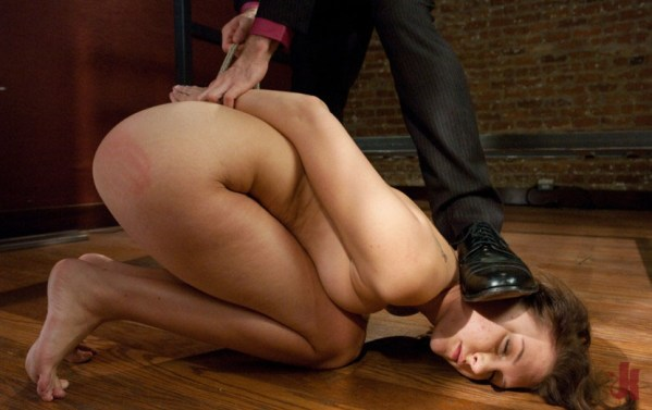 Cute girl is tied up and has her face pushed to the floor by stranger