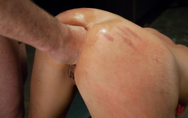 Kinky brunette gets her pretty red ass fisted by a Dominant man