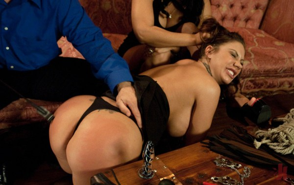 Busty brunette gets her ass whipped by a Dominant man and has her hair pulled by his partner