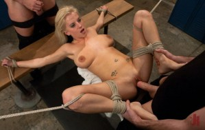 Blonde slut gets tied up to a bench and fucked in her pussy by two guys in extreme public sex