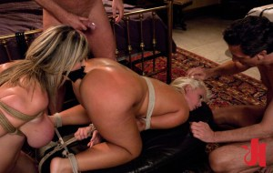 Tied up blonde gets her ass fucked by a blonde wearing a gag dildo while both being tied up