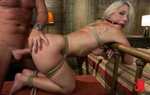 Blonde whore is tied up, gagged and bent over a ben frame so that she may be brutally fucked