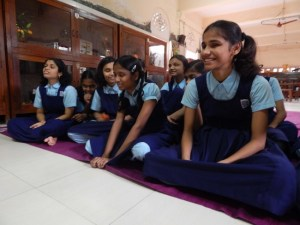 A group of visually-impaired girls sharing a laugh together during a workshop