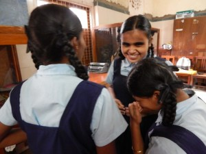 A group of young girls giggling at Kamla Mehta School for the Blind during a workshop