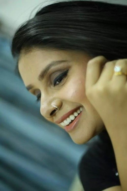 This is a close up photo of Virali Modi. She is looking away from the camera to the left and she is smiling.