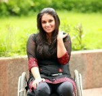 A photo of Virali Modi on a wheelchair.