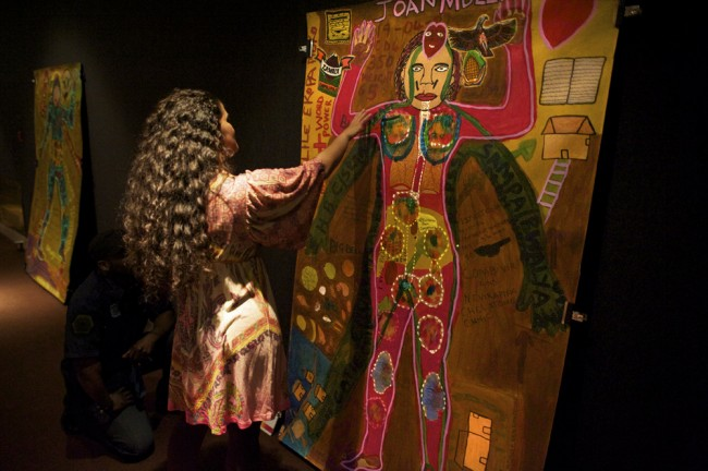 A photo of a women in front of a illustrated body.