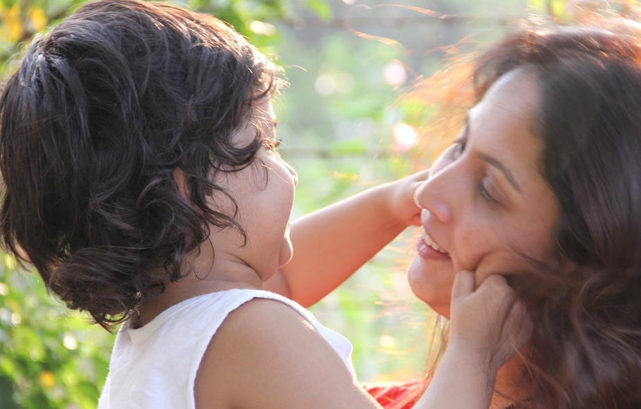 In this photograph, Shilpa Shroff is with her son who is pulling her cheek as they look lovingly at each other.