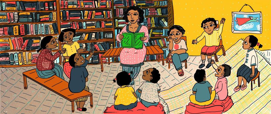In a room full of books in wooden shelves, a woman reads aloud to a bunch of enthusiastic children. On the yellow wall hangs a picture of a superhero flying in the air.