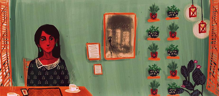 A woman wearing black sits at a cafe desk. A black and white picture hangs on the green wall behind her. To the right, there are plants and lanterns.