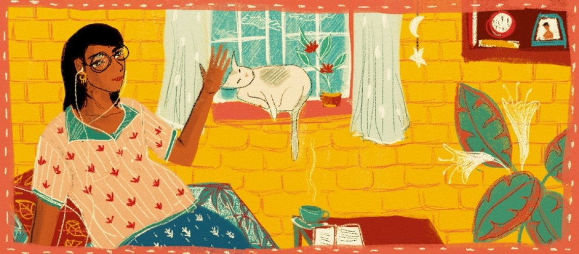 A person sits resting on a pillow, in the background, a cat sits on the windowsill and a yellow brick wall.