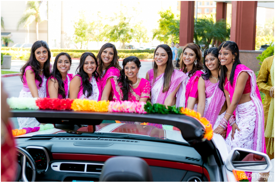 Bridesmaids at Indian wedding blocking the car before getting their gifts
