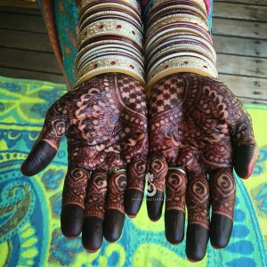 Mehndi and chura on an Indian bride's hands
