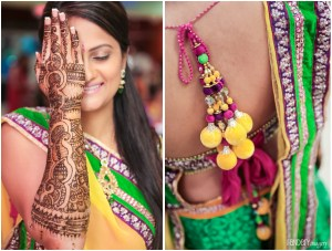 gorgeous photo of an Indian bride covering one half of her face to show her mehndi up to her elbows