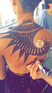 Mehndi by Neha Assar drawn on a woman's back