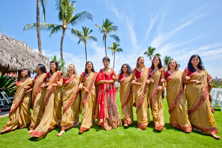 Indian bride photoshoot with her bridesmaids wearing matching saris for their beachfront destination wedding on Maui