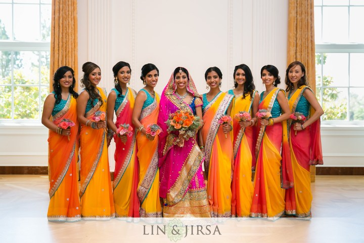 Indian bride with her bridesmaids wearing beautiful multicolored saris.