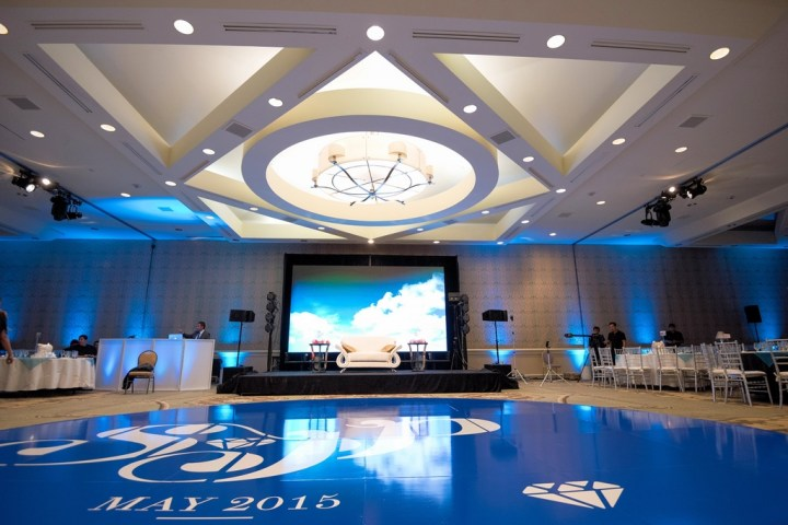 Extravagant Indian wedding with a custom-made blue circular dance floor used in the ballroom after the Hindu wedding ceremony.