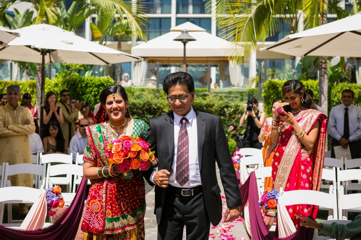 Newport-Beach-Marriott-Indian-Wedding-Photography-bouquet-walking-down-aisle-dad-sari-lehenga-bouquet