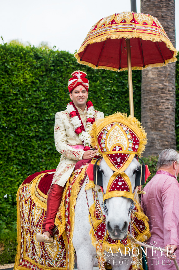Indian groom on decorated horse for the baraat.