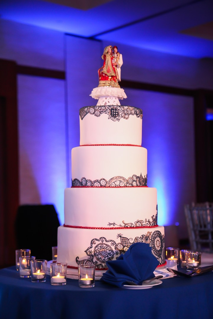multi-tiered mehndi cake at an Indian wedding reception