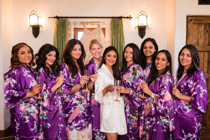 Indian bride with her bridesmaids before the Gujarati, Hindu, Indian wedding