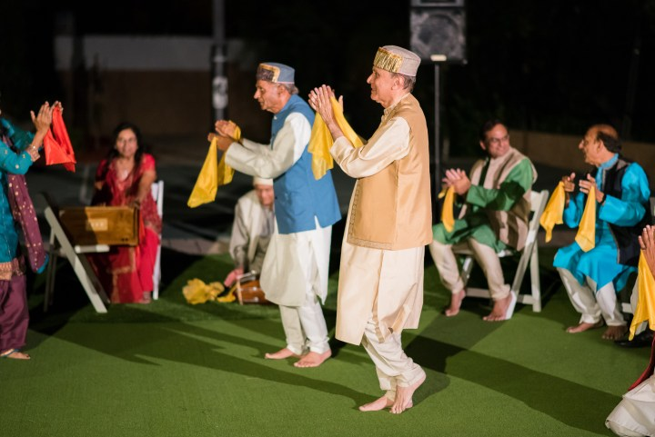 Indian uncles performing a qawwali song at the mehndi night of this Gujaati, Hindu, Indian wedding