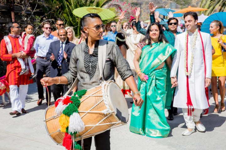 Dhol player at the baraat of an Indian wedding in Malibu