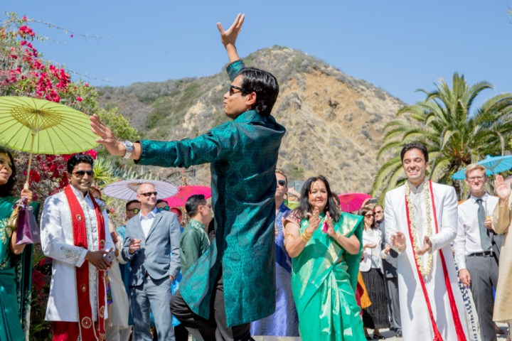 A baraati dancing as they make their way to the mandap
