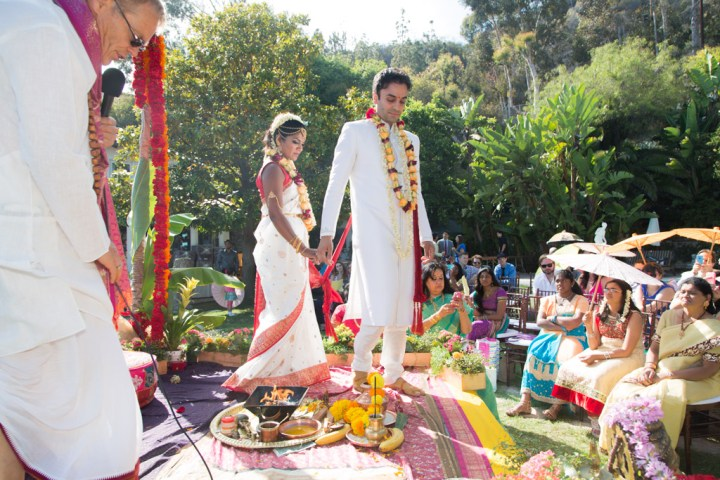 Indian bride and groom taking pheres at their Hindu wedding ceremony