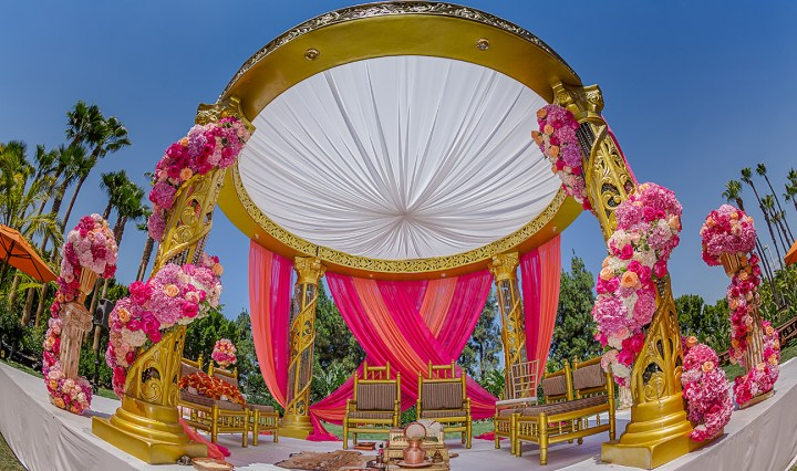 Pink mandap for an outdoor Indian wedding