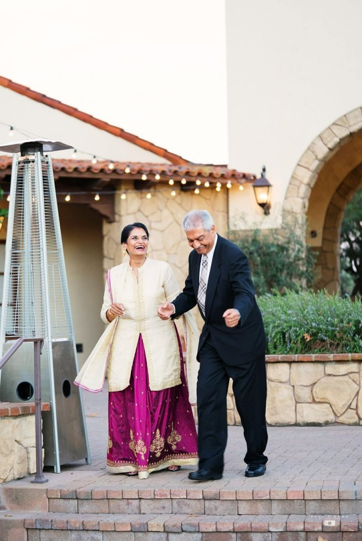 Oak-Creek-Irvine-Indian-wedding-Hindu-ceremony-reception-DJ-Nick-Datwani-outdoor-wedding-South-Asian-wedding-bride-parents-dancing-Avni-Taylor