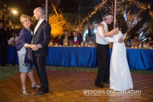 groom's parents dancing with the bride and groom at wedding reception