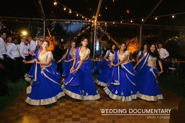 Bridesmaids performing a Bollywood dance at an Indian wedding reception