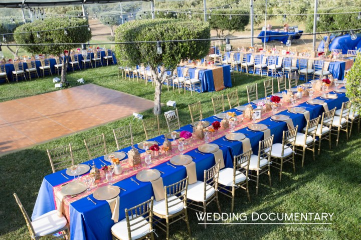 Outdoor Indian wedding with Western flare. Chrger plates and blue color scheme.
