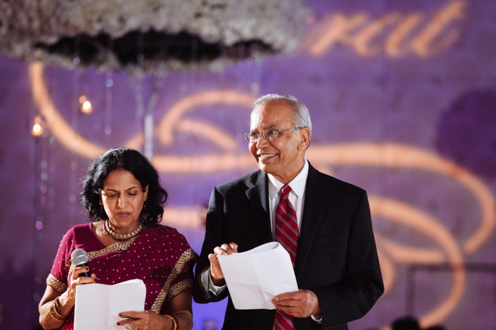 The groom's parents giving a speech at their son's wedding reception.