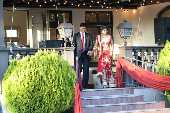 Smita-Aravind-Indian-wedding-mandap-Hindu-outdoor-wedding-ceremony-bride-walking-down-aisle-lehenga-dupatta-mehndi-tikka-nosering-nath-Tamil-Oriya-grand-entrance
