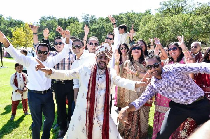 Indian groom dancing in his baraat.