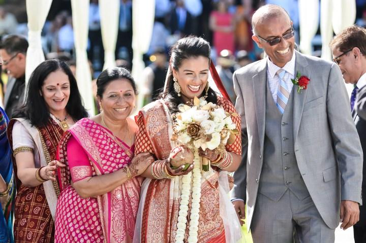 Rakhee-Amrish-gift-exchange-Indian-wedding-venue-photography-Greycard-Hindu-outdoor-dresses-bride-groom-vineyard-South-Asian-wedding-bride-walk-down-aisle-parents